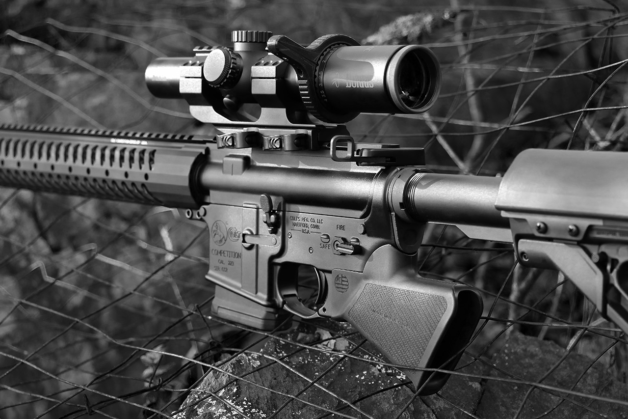 Sparrow Dynamics California AR-15 Rifle on fencing black and white