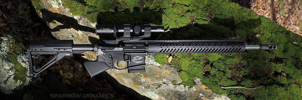 Sparrow Dynamics Featureless Grip Colt Competition Rifle on moss rock