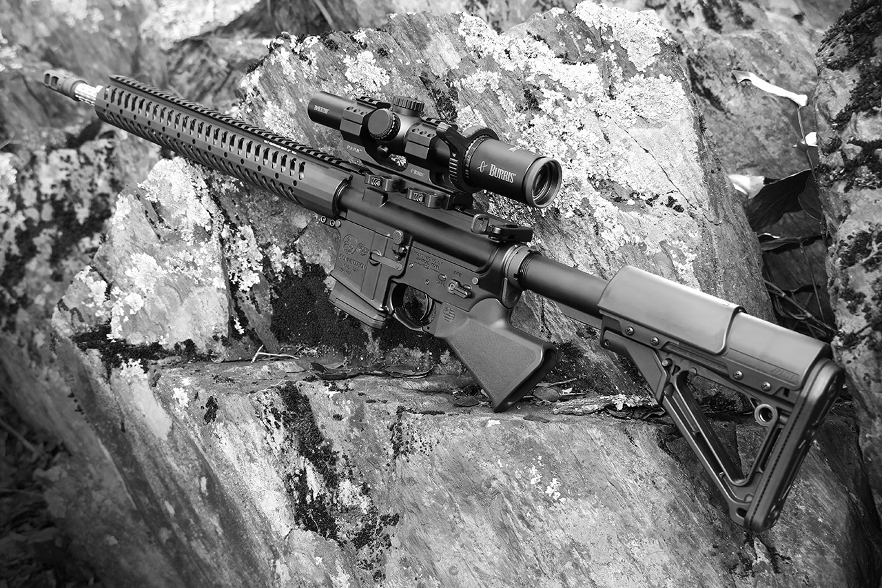 Sparrow Dynamics California compliant Colt Competition Rifle on rock black and white